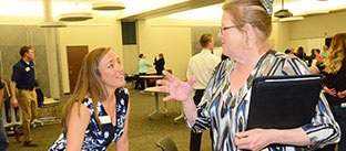 picture of two ladies talking at the job fair